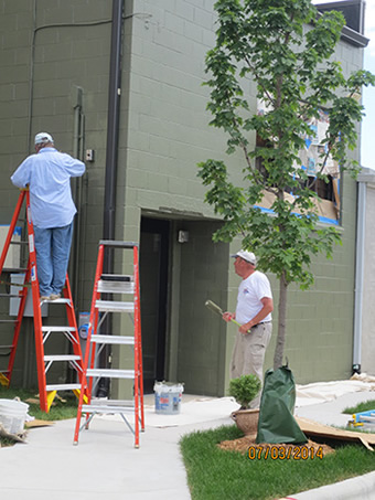 Painting the West Exterior of the Resource Center